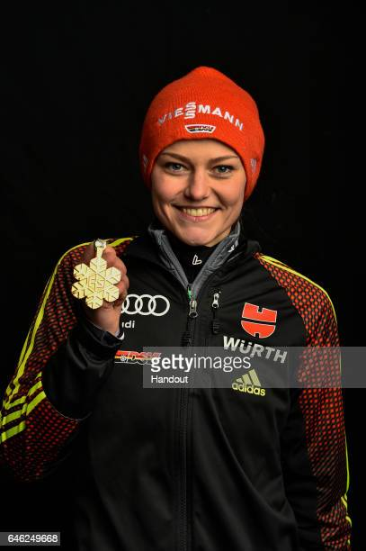 In this handout supplied by NordicFocus Carina Vogt of Germany poses with the Gold medal after the medal ceremony for the Women's Ski Jumping HS100...