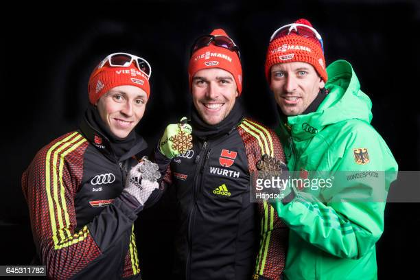 In this handout supplied by NordicFocus Gold medallist Johannes Rydzek of Germany silver medallist Eric Frenzel of Germany and Bjoern Kircheisen of...
