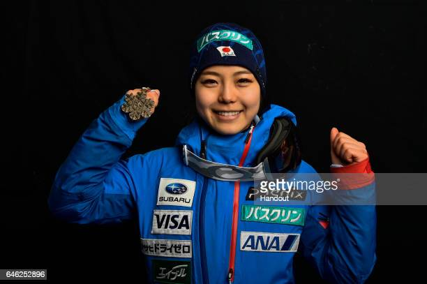 In this handout supplied by NordicFocus Sara Takanashi of Japan poses with the Bronze medal after the medal ceremony for the Women's Ski Jumping...