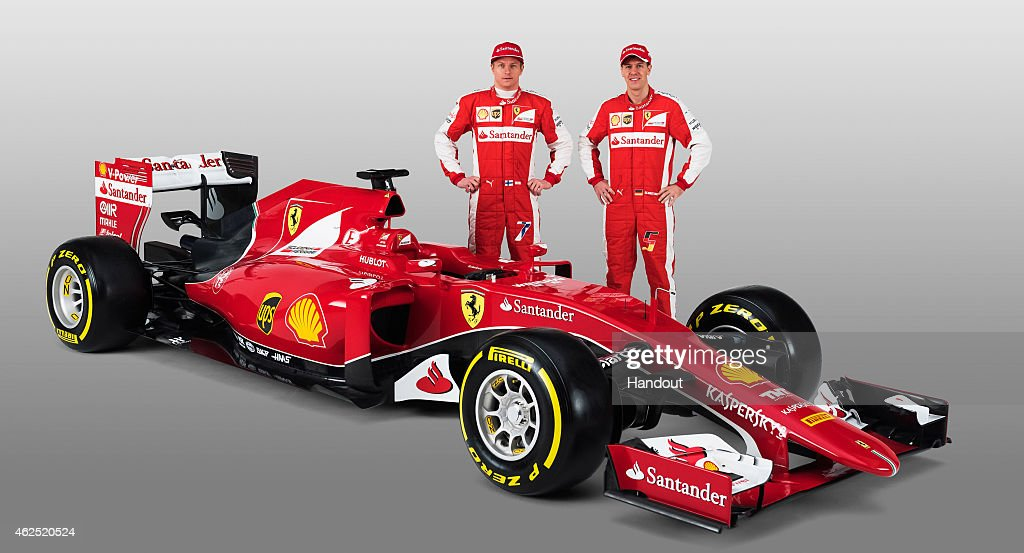 In this handout supplied by Scuderia Ferrari, Kimi Raikkonen and <a gi-track='captionPersonalityLinkClicked' href=/galleries/search?phrase=Sebastian+Vettel&family=editorial&specificpeople=2233605 ng-click='$event.stopPropagation()'>Sebastian Vettel</a> attend the unveiling of their new SF15-T Formula One car on January 30, 2015 in Maranello, Italy.