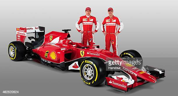 In this handout supplied by Scuderia Ferrari Kimi Raikkonen and Sebastian Vettel attend the unveiling of their new SF15T Formula One car on January...