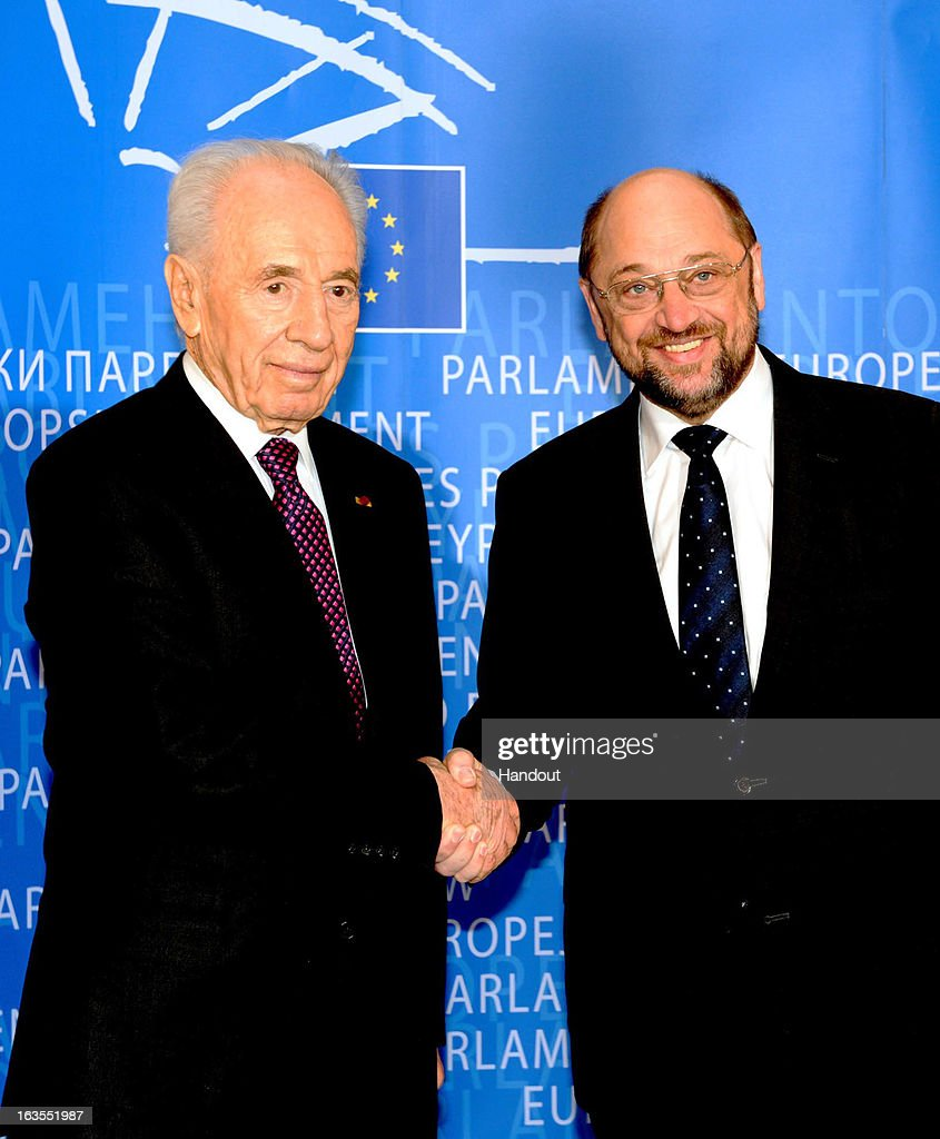 In this handout supplied by the Israeli Government press office (GPO), Israeli President Shimon Peres is greeted by European Parliament President Martin Schulz at the European Parliament, on March 12, 2013 in Strasbourg, France. Peres has been travelling between Brussels, Paris and Strasbourg to meet with leaders and address the European Parliament, a first for an Israeli leader.