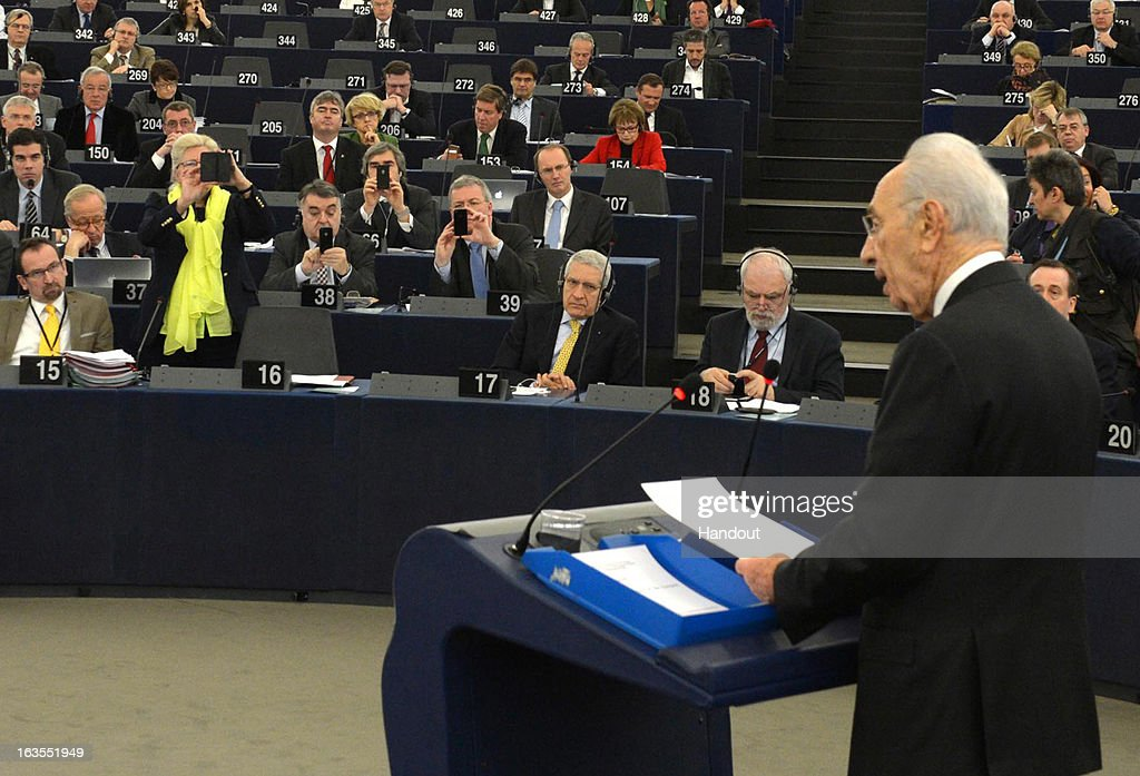 In this handout supplied by the Israeli Government press office (GPO), Delegates take photographs as Israeli President Shimon Peres delivers an address to the European Parliament, on March 12, 2013 in Strasbourg, France. Peres has been travelling between Brussels, Paris and Strasbourg to meet with leaders and address the European Parliament, a first for an Israeli leader.
