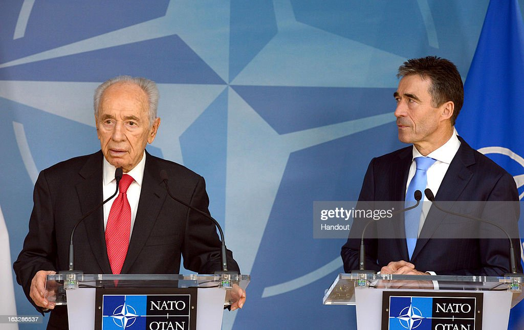 In this handout supplied by the the Israeli Government press office (GPO), Israeli President Shimon Peres attends a press conference with Nato Secretary Anders Fogh Rasmussen, on March 7, 2013 in Brussels, Belgium. Peres is traveling to Brussels, Paris and Strasbourg where he will address the European Parliament, a first for an Israeli leader.