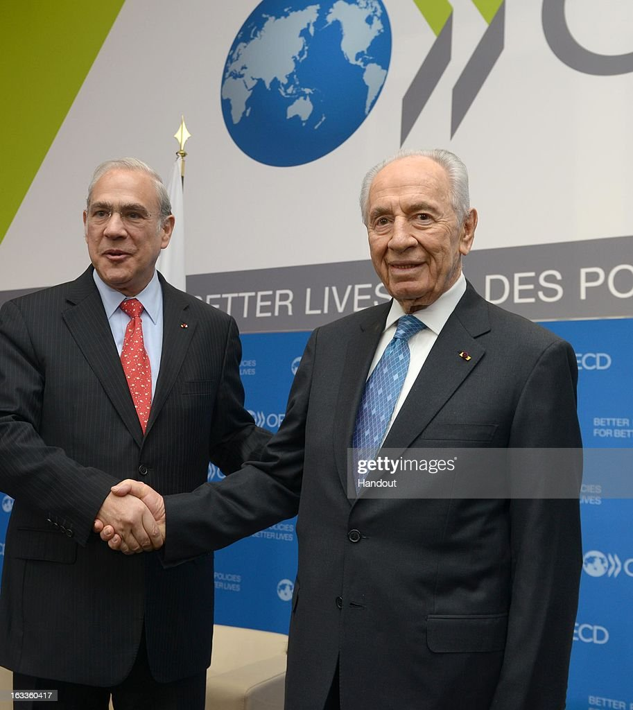In this handout supplied by the the Israeli Government press office (GPO), Israeli President Shimon Peres meets with OECD Secretary-General Angel Gurria (L) at the OECD on March 8, 2013 in Paris, France. Peres is traveling to Brussels, Paris and Strasbourg where he will address the European Parliament, a first for an Israeli leader.