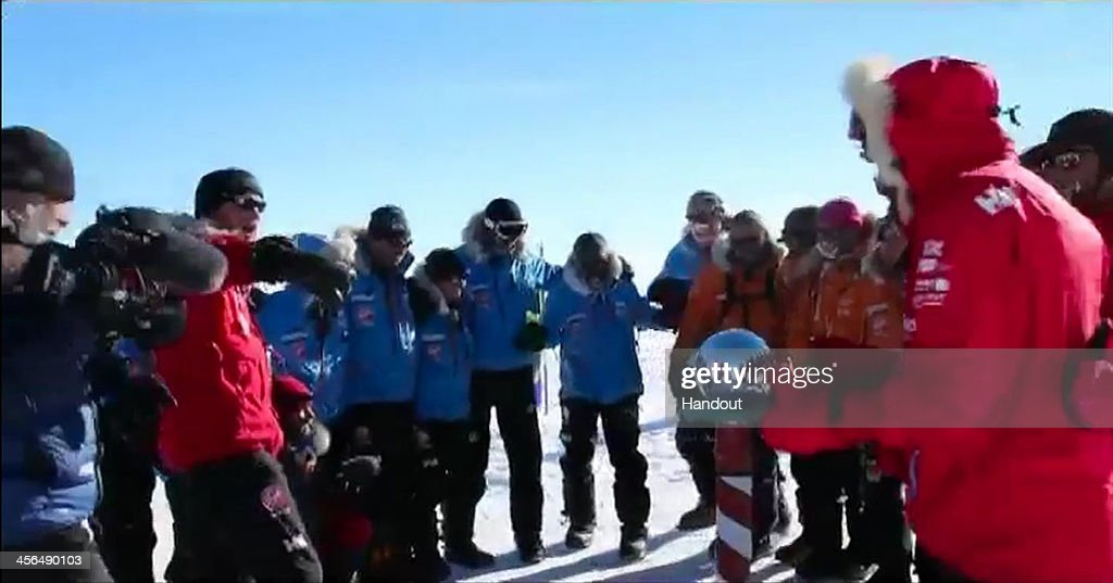 In this handout video grab provided by Walking with the Wounded, Prince Harry (2nd L) and his fellow adventurers reach the South Pole as part of their Walking With The Wounded charity trek on December 13, 2013 in Antartica. The Virgin Money South Pole Allied Challenge 2013, of which Prince Harry is patron, will see the participants race across three degrees to the South Pole. All 12 injured service personnel from Britain, America, Canada and Australia have overcome life-changing injuries and undertaken challenging training programmes to prepare themselves for the conditions they will face in Antarctica. Trekking around 15km to 20km per day, the teams endured temperatures as low as minus 45C and 50mph winds as they pulled their 70kg sleds to the south pole.