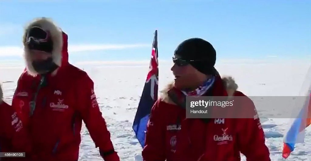 In this handout video grab provided by Walking with the Wounded, Prince Harry (R) and his fellow adventurers reach the South Pole as part of their Walking With The Wounded charity trek on December 13, 2013 in Antartica. The Virgin Money South Pole Allied Challenge 2013, of which Prince Harry is patron, will see the participants race across three degrees to the South Pole. All 12 injured service personnel from Britain, America, Canada and Australia have overcome life-changing injuries and undertaken challenging training programmes to prepare themselves for the conditions they will face in Antarctica. Trekking around 15km to 20km per day, the teams endured temperatures as low as minus 45C and 50mph winds as they pulled their 70kg sleds to the south pole.