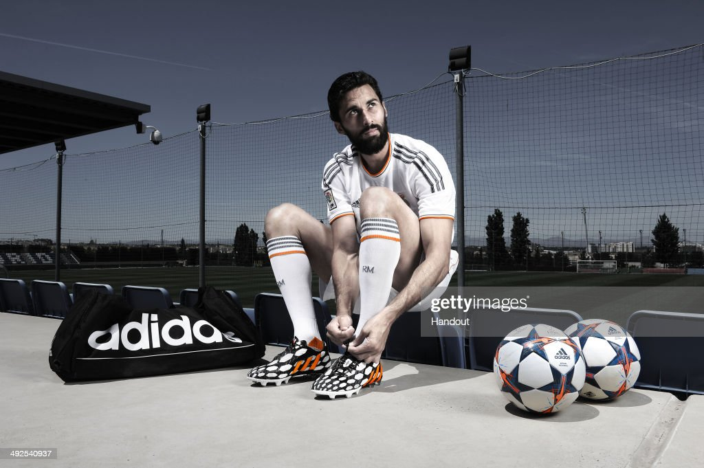 In this image from adidas, <a gi-track='captionPersonalityLinkClicked' href=/galleries/search?phrase=Alvaro+Arbeloa&family=editorial&specificpeople=3941965 ng-click='$event.stopPropagation()'>Alvaro Arbeloa</a> of Real Madrid tries on his adidas Predator Battle Pack boots ahead of Saturday's UEFA Champions League Final at the Ciudad Real Madrid training complex in Madrid, Spain.