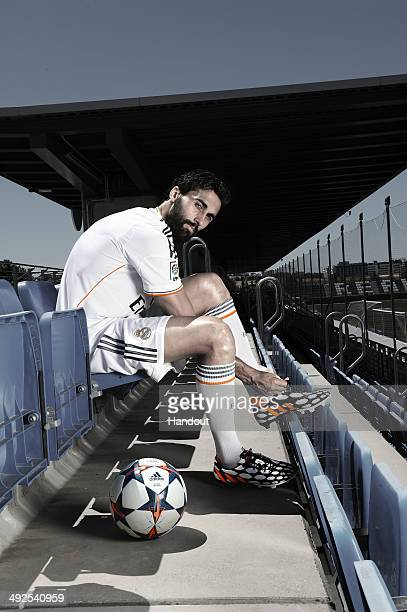 In this image from adidas Alvaro Arbeloa of Real Madrid tries on his adidas Predator Battle Pack boots ahead of Saturday's UEFA Champions League...