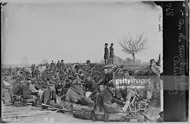 In this image from the US Library of Congress Soldiers sit in trenches in 1864 near Petersburg Virginia
