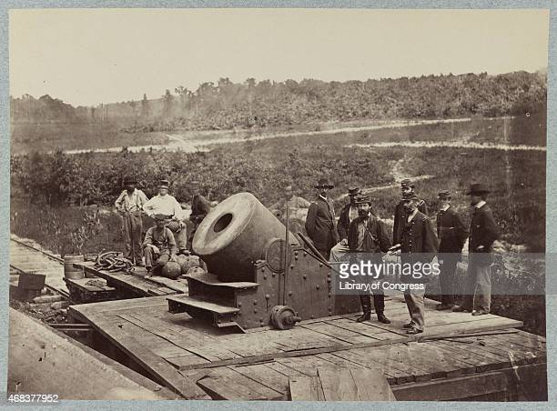 In this image from the US Library of Congress Union officers and enlisted men stand around a 13 inch mortar the 'Dictator' on the platform of a...