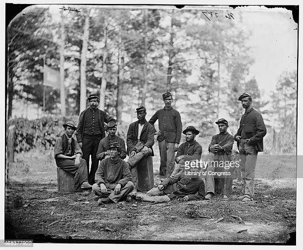 In this image from the US Library of Congress Union soldiers from Company D US Engineer Battalion pose during the siege in August 1864 in Petersburg...