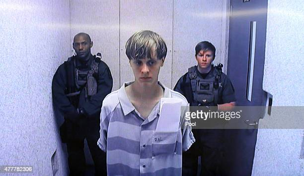 In this image from the video uplink from the detention center to the courtroom Dylann Roof appears at Centralized Bond Hearing Court June 19 2015 in...