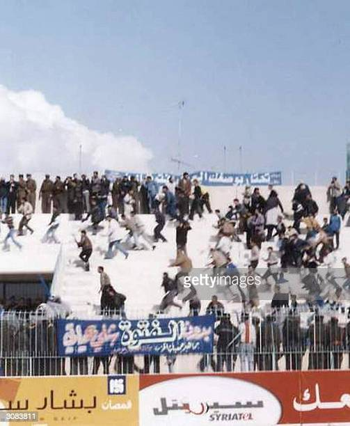 In this image made available 14 March 2004 soccer fans riot following a match between the alFitwa and the alJihad teams at the main stadium in the...