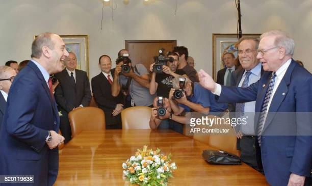 In this image made available by the Israeli Government Press office 18 September 2006 Israeli Prime Minister Ehud Olmert shares a light moment with...