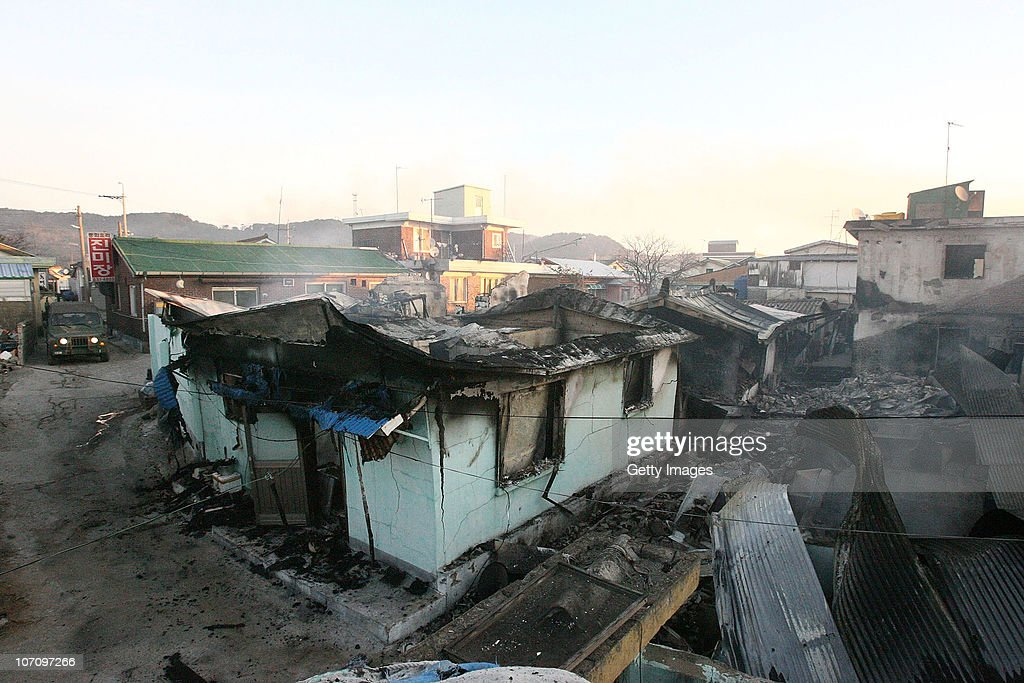 In this image provided by a local resident Destroyed houses are seen on Yeonpyeong Island South Korea following artillery exchange between North and...