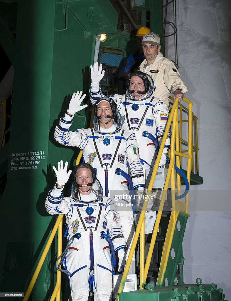 In this image provided by NASA, Expedition 36/37 Soyuz Commander Fyodor Yurchikhin of the Russian Federal Space Agency (Roscosmos), top, Flight Engineers: Luca Parmitano of the European Space Agency, center, and Karen Nyberg of NASA, bottom, wave farewell as they board the Soyuz rocket ahead of their launch to the International Space Station, on May 29, 2013 in Baikonur, Kazakhstan. Yurchikhin, Nyberg, and, Parmitano, will remain aboard the station until mid-November.
