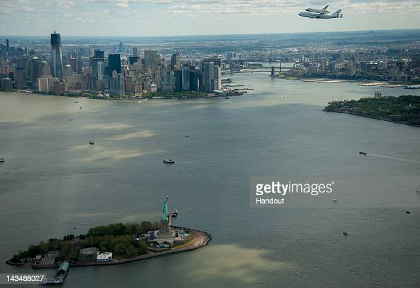 In this image provided by NASA the space shuttle Enterprise mounted atop a NASA 747 Shuttle Carrier Aircraft flies near the Statue of Liberty and the...
