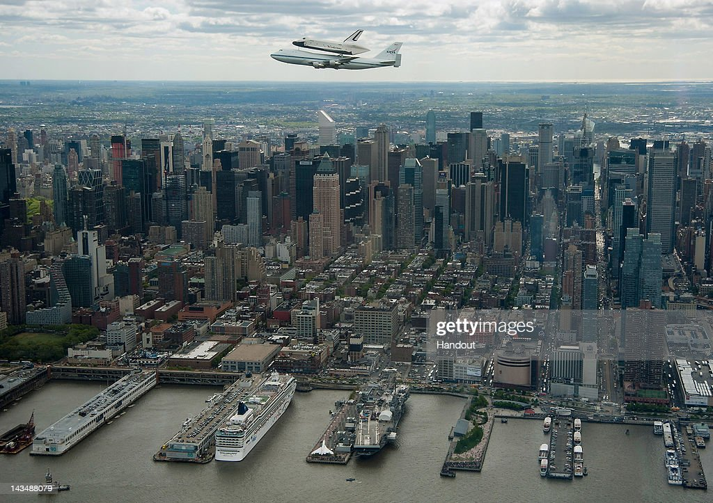 In this image provided by NASA, the space shuttle Enterprise, mounted atop a NASA 747 Shuttle Carrier Aircraft (SCA), flies near the Intrepid Sea, Air and Space Museum, April 27, 2012, in New York City. Enterprise was the first shuttle orbiter built for NASA performing test flights in the atmosphere and was incapable of spaceflight. Originally housed at the Smithsonian's Steven F. Udvar-Hazy Center, Enterprise will be demated from the SCA and placed on a barge that will eventually be moved by tugboat up the Hudson River to the Intrepid Sea, Air & Space Museum.