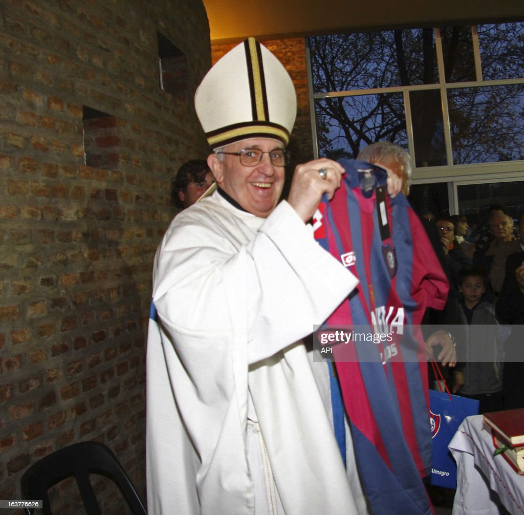 In this image provided by the San Lorenzo Futbol Club, Jorge Mario Bergoglio, holds a team shirt, in Buenos Aires, Argentina.
