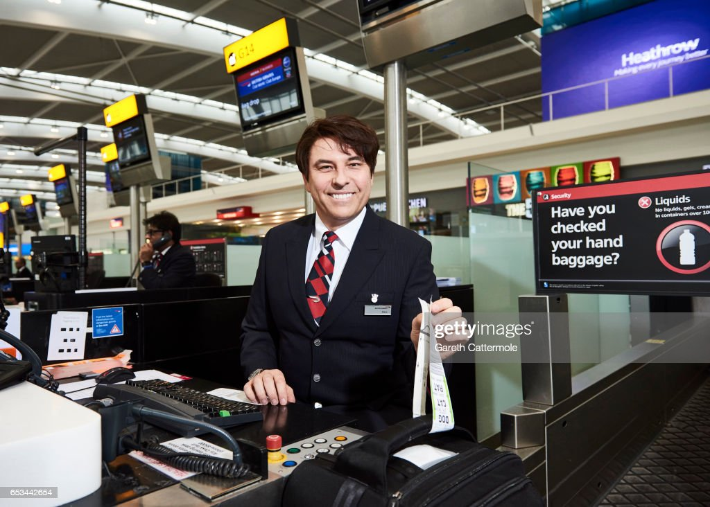 In this image released by British Airways today, March 15th 2017, in London, England, David Walliams checks-in British Airways passengers at Heathrow T5 as part of the airlines Red Nose Day campaign, which launches today. David was joined by Emma Bunton and Tom Daley who also dressed as British Airways staff to surprise customers for Red Nose Day, which takes place on March 24. The airline has raised more than £15 million for the charity over the past seven years. The films can be viewed at youtube.com/britishairways.