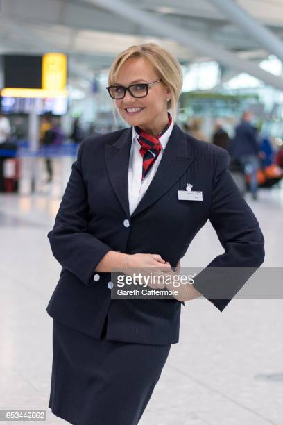 In this image released by British Airways today March 15th 2017 in London England Emma Bunton assists British Airways passengers at Heathrow T5 as...