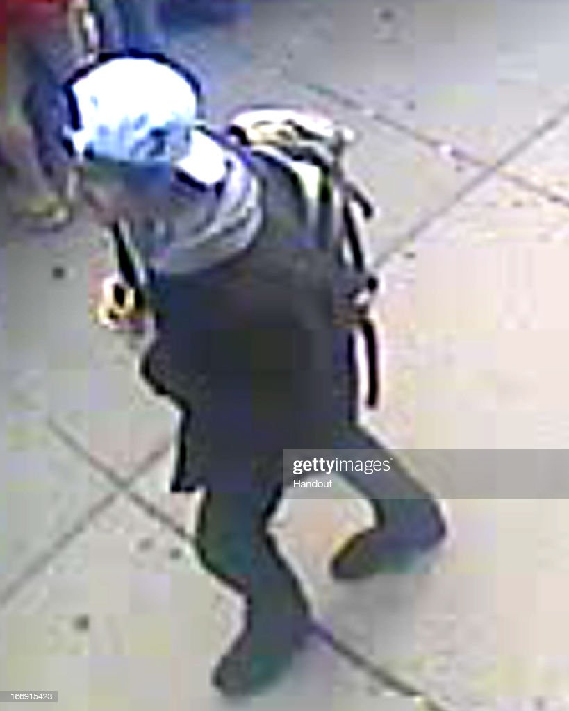 In this image released by the Federal Bureau of Investigation (FBI) on April 18, 2013, a suspect in the Boston Marathon bombing walks near the marathon finish line on April 15, 2013 in Boston, Massachusetts. The twin bombings at the 116-year-old Boston race resulted in the deaths of three people with more than 170 others injured.