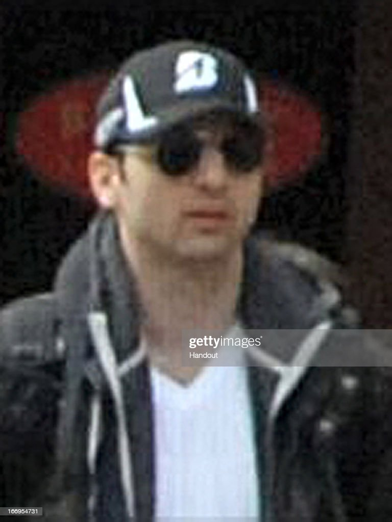 In this image released by the Federal Bureau of Investigation (FBI) on April 19, 2013, a suspect in the Boston Marathon bombing walks near the marathon finish line on April 15, 2013 in Boston, Massachusetts. The twin bombings at the 116-year-old Boston race resulted in the deaths of three people with more than 170 others injured.
