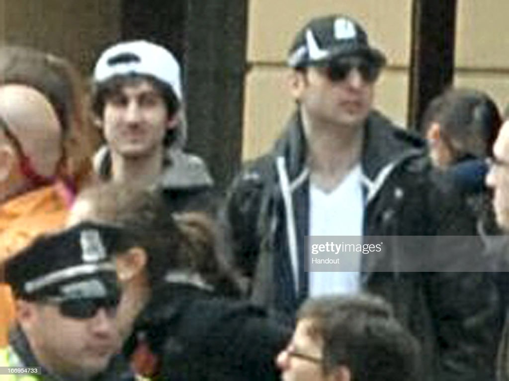 In this image released by the Federal Bureau of Investigation (FBI) on April 19, 2013, two suspects in the Boston Marathon bombing walk near the marathon finish line on April 15, 2013 in Boston, Massachusetts. The twin bombings at the 116-year-old Boston race resulted in the deaths of three people with more than 170 others injured.