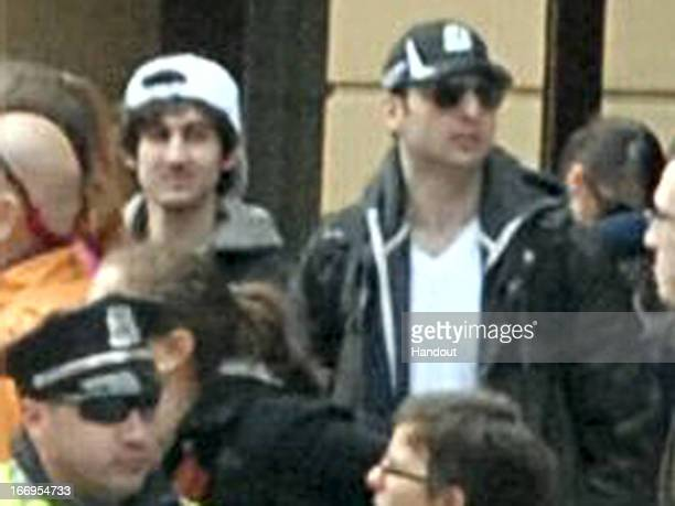 In this image released by the Federal Bureau of Investigation on April 19 two suspects in the Boston Marathon bombing walk near the marathon finish...