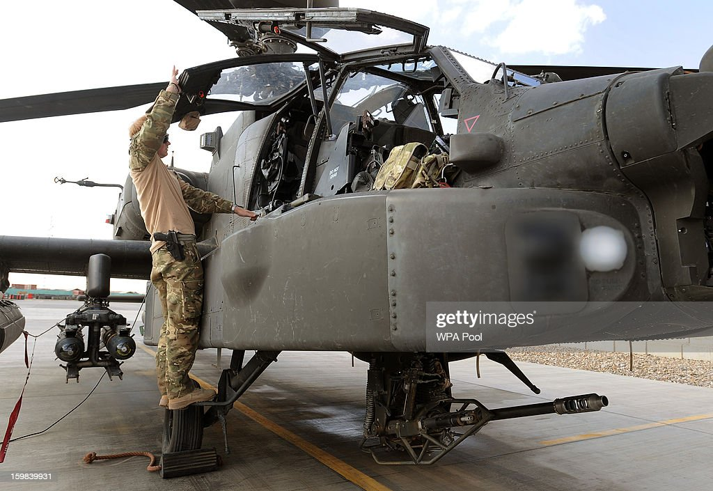 In this image released on January 21, 2013, Prince Harry prepares an Apache helicopter at the British controlled flight-line in Camp Bastion on October 31, 2013 in Afghanistan. Prince Harry has served as an Apache Helicopter Pilot/Gunner with 662 Sqd Army Air Corps, from September 2012 for four months until January 2013.