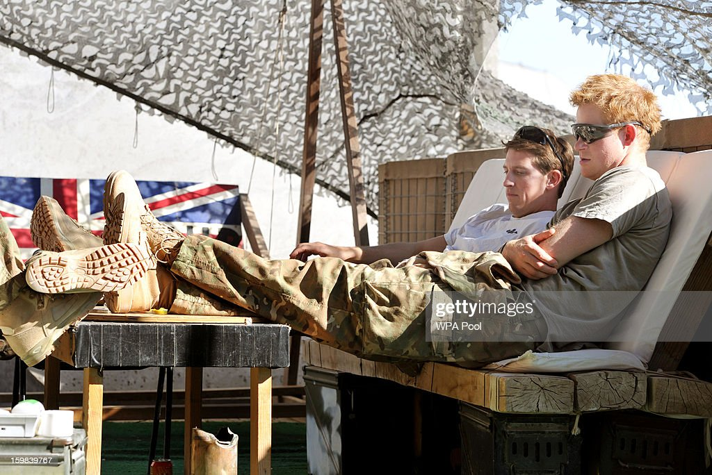 In this image released on January 21 Prince Harry relaxes with fellow Pilots in their VHR at the British controlled flightline in Camp Bastion...