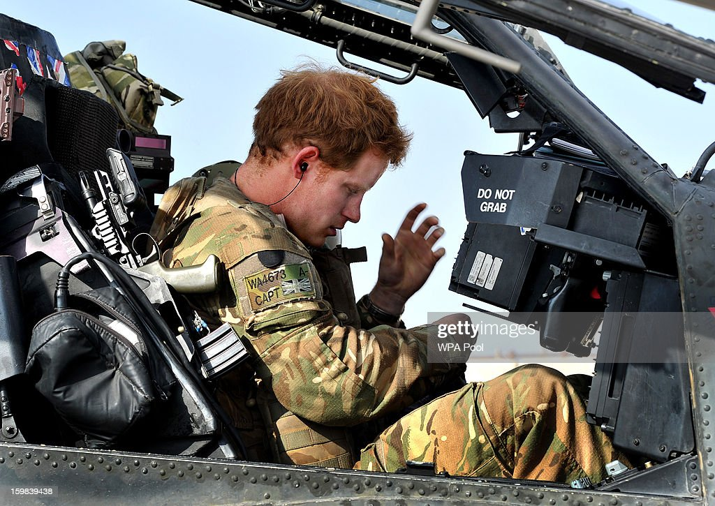 In this image released on January 21, 2013, Prince Harry sits in the front seat of his cockpit in Camp Bastion on October 31, 2012 in Afghanistan. Prince Harry has served as an Apache Helicopter Pilot/Gunner with 662 Sqd Army Air Corps, from September 2012 for four months until January 2013.