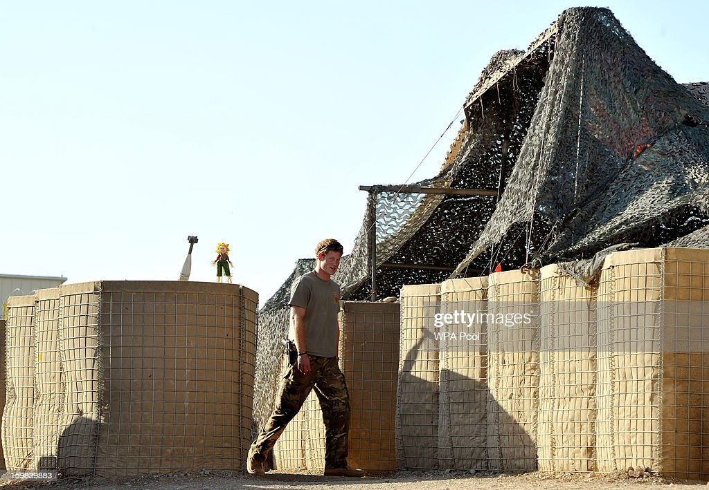 In this image released on January 21 Prince Harry walks towards the VHR tent to start his 12 hour shift at the British controlled flightline in Camp...