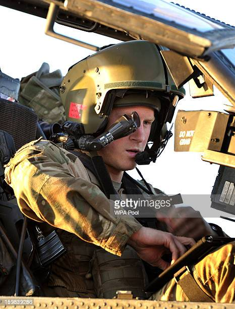 In this image released on January 21 Prince Harry wears his monocle gun sight as he sits in the front seat of his cockpit where he has served as an...