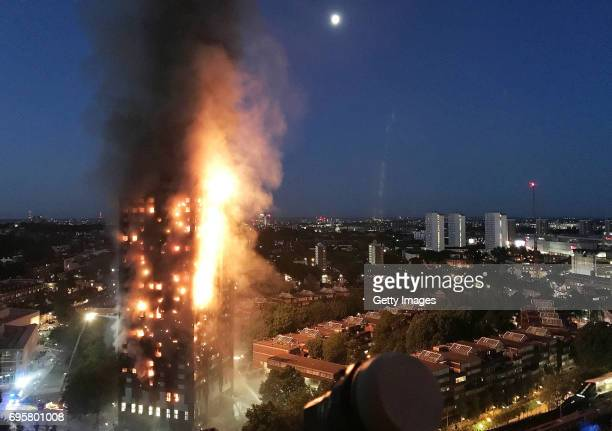 In this image taken by eyewitness Gurbuz Binici a huge fire engulfs the 24 story Grenfell Tower in Latimer Road West London in the early hours of...