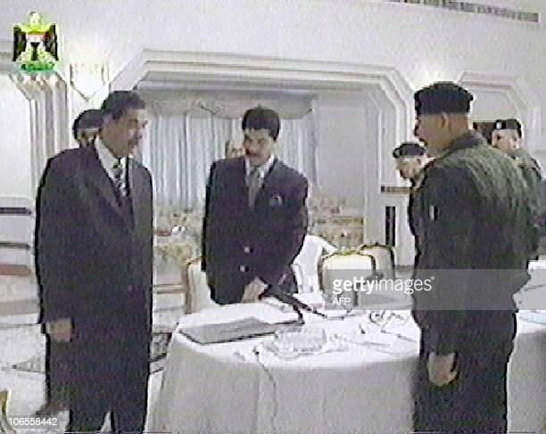 In this image taken off Iraqi television Iraqi President Saddam Hussein is followed by his personal secretary Abed Hmoud his son Qusay as Iraq's No2...