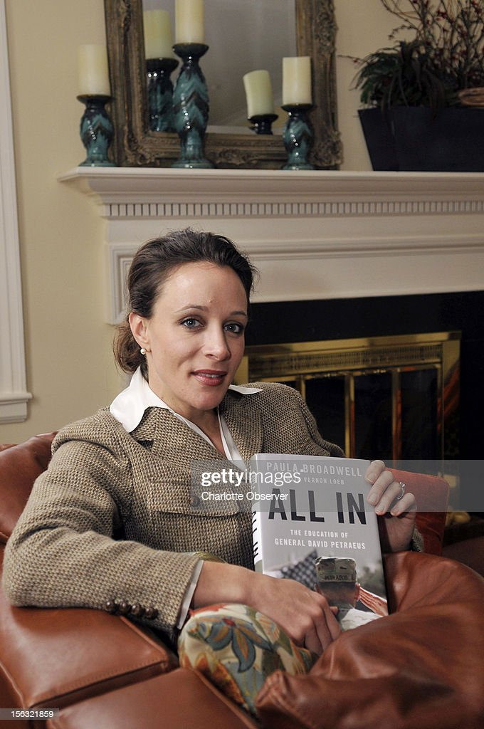In this January 14, 2012 photo, Paula Broadwell, author of the David Petraeus biography 'All In,' poses for photos in Charlotte, North Carolina. Petraeus, the retired four-star general renowned for taking charge of the military campaigns in Iraq and then Afghanistan, abruptly resigned November 9, 2012 as director of the CIA, admitting to an extramarital affair. Petraeus carried on the affair with Broadwell, according to several U.S. officials with knowledge of the situation.