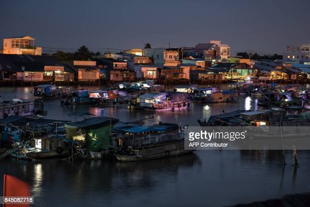 In this July 17 2017 photograph boats lie anchored in a canal off the Song Hau river in the floating Cai Rang market in Can Tho a small city of the...