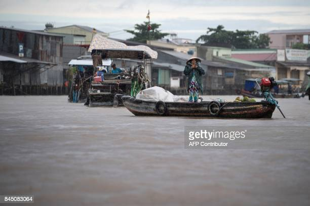 In this July 17 2017 photograph Nguyen Kim Truong who sells food and drinks in a canal off the Song Hau river in the floating Cai Rang market in Can...