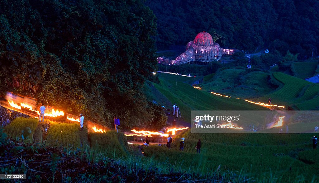 In this long exposure image, people walk with fire torches during 'Mushi Okuri' ritual, on July 6, 2013 in Shodoshima, Kagawa, Japan. The ritual, 'Mushi (insects) Okuri (sending, or removing)' held to pray for good hearvest by removing harmful insects with fire torch.