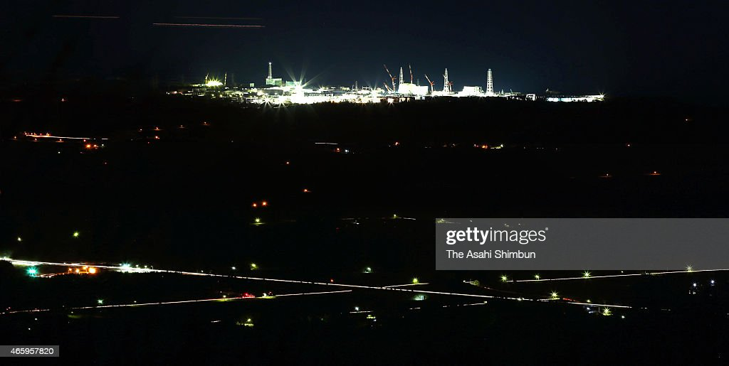 In this long exposure image Tokyo Electric Power Co's Fukushima Daiichi Nuclear Power Plant is seen on March 12 2015 in Tomioka Fukushima Japan Four...