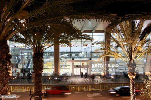 In this long time exposure photo protesters march during a rally against the travel ban at San Diego International Airport on March 6 2017 in San...