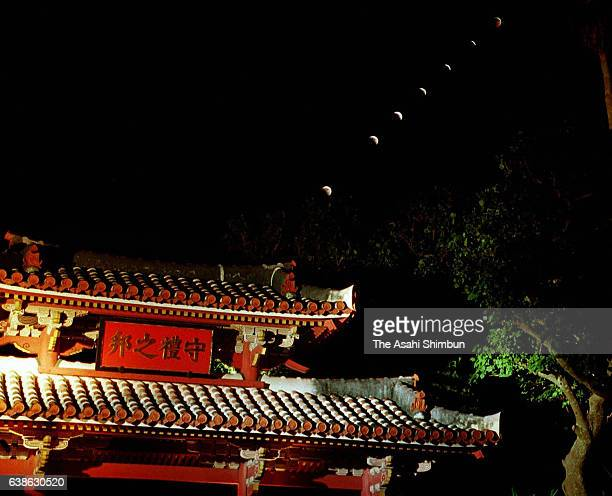 In this multiple exposure image a total lunar eclipse is observed above Shuri Castle on July 16 2000 in Naha Okinawa Japan