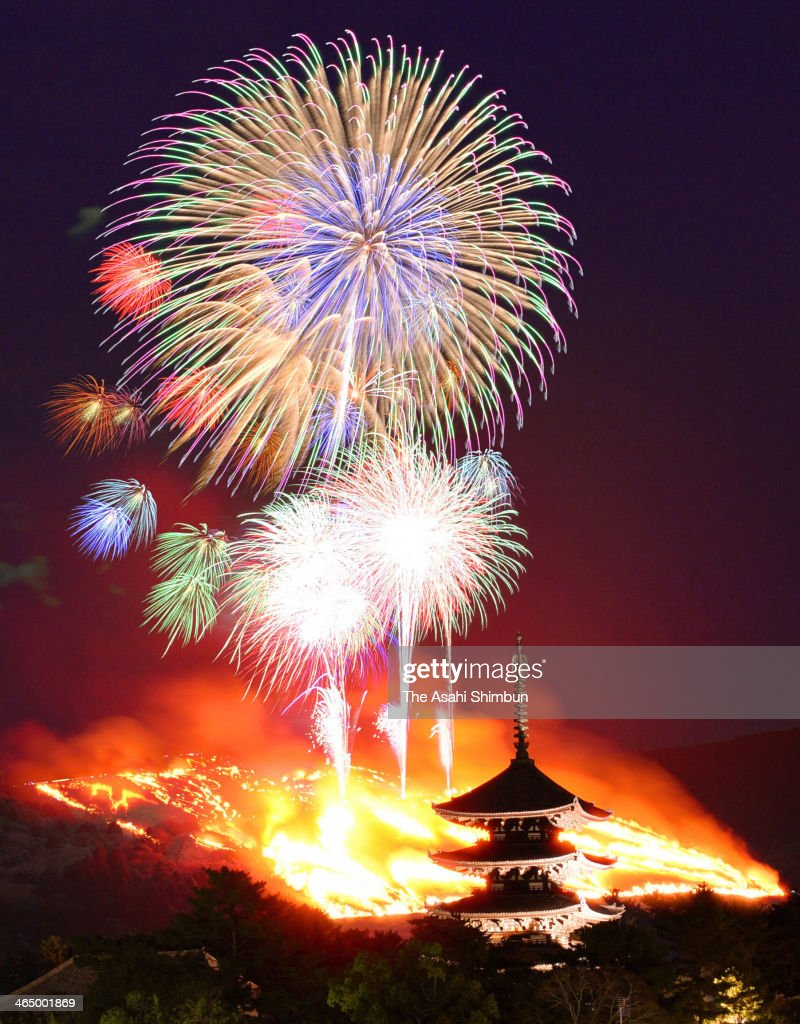In this multiple exposure image, fireworks explode during the Yamayaki (grass-burning) festival at Wakakusa yama hill on January 25, 2014 in Nara, Japan. The annual winter event attracted 180,000 people.