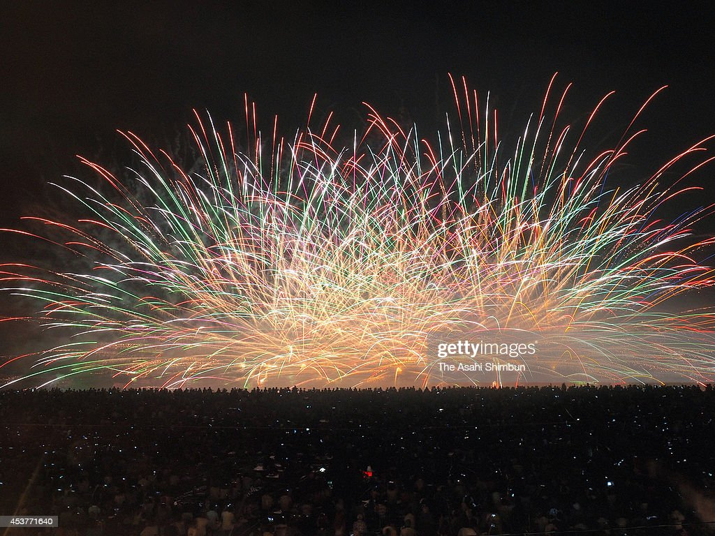 In this multiple exposure image, people enjoy fireworks during the Kumano Fireworks festival on August 17, 2014 in Kumano, Mie, Japan.