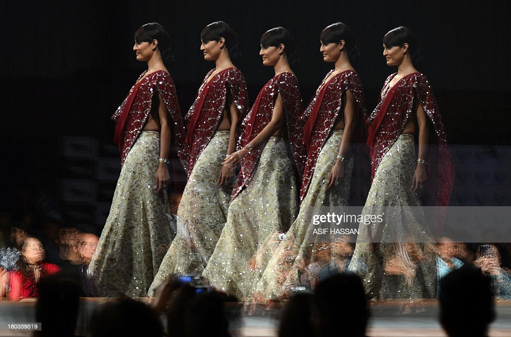 In this multiple exposure photo, a Pakistani model presents a creation by designer Usman Dittu on the last day of Karachi Fashion Week in Karachi on late January 29, 2013. AFP PHOTO/ ASIF HASSAN