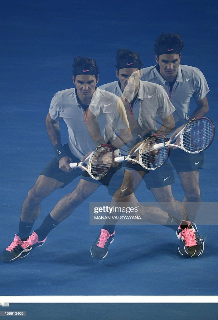 In this multiple exposure photograph Switzerland's Roger Federer hits a return against France's Jo-Wilfried Tsonga during their men's singles match on day ten of the Australian Open tennis tournament in Melbourne on January 23, 2013. AFP PHOTO / MANAN VATSYAYANA IMAGE STRICTLY RESTRICTED TO EDITORIAL USE - STRICTLY NO COMMERCIAL USE
