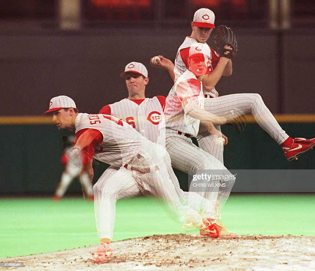 In this multiple-exposure picture, Cincinnati Reds starting pitcher Pete Schourek delivers to the plate against the Atlanta Braves in the second inning during game one of the National League Championship Series at Riverfront Stadium in Cincinnati, Ohio 10 October. AFP PHOTO
