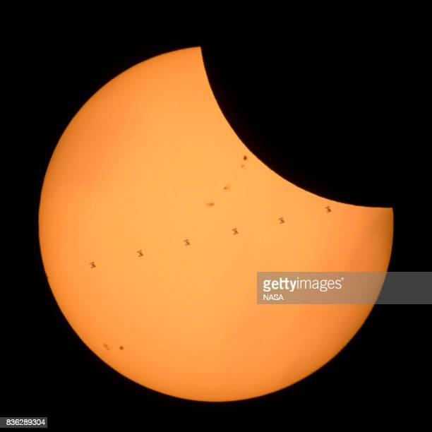 In this NASA handout acomposite image made from seven frames shows the International Space Station with a crew of six onboard as it transits the Sun...